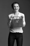 Happy elegant woman with shopping bag against grey background Stock Images