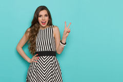 Happy Elegant Woman Showing Peace Hand Sign Royalty Free Stock Image