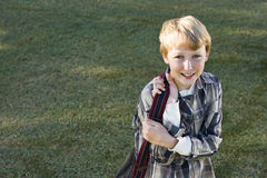 Happy elementary school boy with bookbag Stock Photo