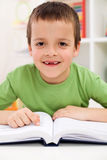 Happy elementary school boy practice reading Stock Photo