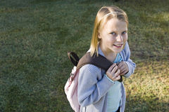 Happy elementary school girl with her bookbag Royalty Free Stock Photo