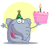 Happy elephant holds birthday cake Royalty Free Stock Photos