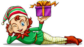 A happy elf holding a gift Stock Photo