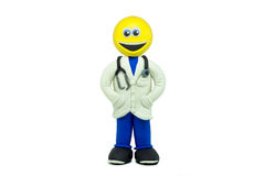 A happy emoticon dressed as a doctor and smiling made in plasticine Stock Photography