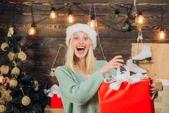 Happy emotion. Euphoria. Crazy comical face. Smiling woman decorating Christmas tree at home. December surprise and. Party time. Happy new year royalty free stock photos