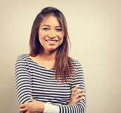 Happy emotion smiling woman with folded arms looking on backgrou Royalty Free Stock Photo