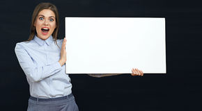 Happy emotional business woman holding white sign board studio p Stock Photography