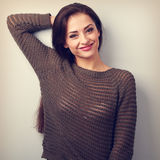 Happy emotional casual brunette woman smiling in warm sweater. V Stock Photos