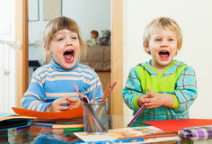 Happy emotional children playing with pencils Royalty Free Stock Photo