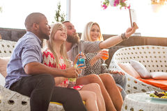 Happy emotional friends taking pictures at lounge Royalty Free Stock Photos