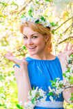 Happy emotional girl in the lush  park Royalty Free Stock Image