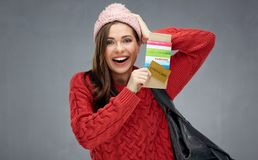 Happy emotional woman wearing red sweater holding ticket and pas Stock Photo