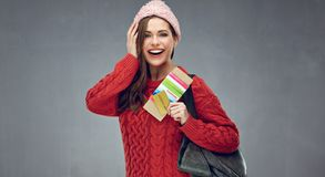 Happy emotional woman wearing red sweater holding ticket and pas. Sport. Winter holiday vacation concept Royalty Free Stock Photo