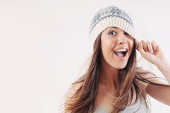Happy emotional woman in winter knitted hat Stock Photo