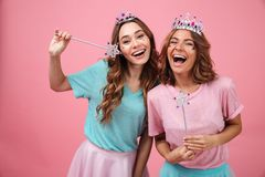 Happy emotional young women friends in princess costumes Royalty Free Stock Photography