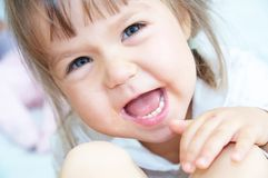 Happy emotionally smiling little girl Royalty Free Stock Photo