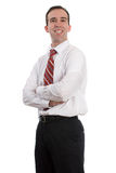 Happy Employee. A happy employee is standing with his arms crossed, isolated against a white background Stock Photo