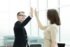 Happy employees giving each other high five. Concept of success royalty free stock image