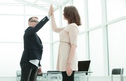 Happy employees giving each other high five. Concept of success royalty free stock photos