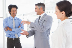 Happy employees having a discussion stock photo