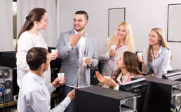 Happy employees and manager celebrating. Employees and smiling manager celebrating good dealing royalty free stock photos