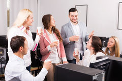 Happy employees and manager celebrating. Employees and young manager celebrating good dealing Stock Images