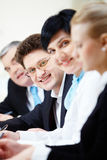 Happy employer. Confident businessman looking at camera among colleagues Royalty Free Stock Photos