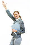 Happy employer. Portrait of successful female raising her arm while looking at camera Royalty Free Stock Photography