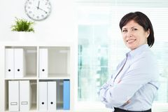 Happy employer. Mature businesswoman looking at camera in office Stock Images