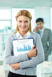Happy employer. Smiling businesswoman looking at camera in working environment Royalty Free Stock Image