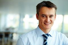 Happy employer. Portrait of attractive male looking at camera with smile Royalty Free Stock Photography