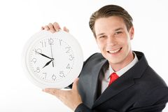 Happy employer. Photo of smiling employer with clock in hands looking at camera royalty free stock photography