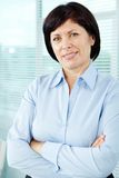 Happy employer. Mature businesswoman looking at camera in office Stock Photography