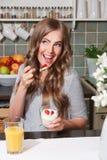 Happy energetic woman on diet eating healthy breakfast Stock Photos