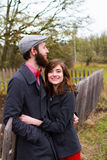 Happy Engaged Couple Portrait. Portrait of a happy couple engaged to be married in the winter outdoors. This couple is modern, trendy, hipster, and fashion first Royalty Free Stock Photos