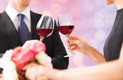 Happy engaged with flowers clinking wine glasses Royalty Free Stock Image