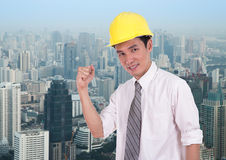 Happy engineer with arm raised, concept of successful, city back Stock Photos