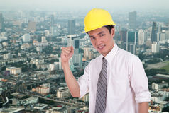 Happy engineer with arm raised, concept of successful, city back Royalty Free Stock Photography