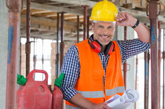 Happy Engineer With Blueprint On Site Royalty Free Stock Photos