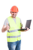 Happy engineer with laptop doing like gesture Royalty Free Stock Image