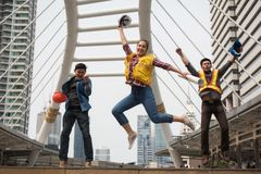 Happy engineer team jump in city. Happy engineer team jumping in Bangkok city after construction project complete. Achieve goals or mission successful for stock image