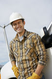 Happy Engineer At Wind Farm Stock Photo