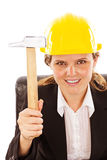 Happy engineer woman with a hammer sitting at desk Stock Images