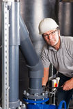 Happy engineer at work. Happy engineer with safety helmet, earplug and glasses Royalty Free Stock Photos