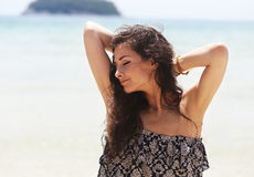 Happy enjoying beautiful closed eyes woman relaxing with epilati Stock Photo