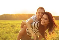 Happy enjoying loving mother hugging her playful laughing kid gi Royalty Free Stock Photo