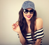 Happy enjoyment young woman in sun glasses and blue baseball cap Royalty Free Stock Images