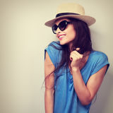 Happy enjoyment young woman in sun glasses and hat posing. Vinta Stock Images