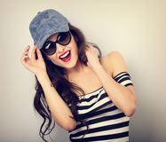 Happy enjoyment young woman in sunglasses and blue baseball cap Stock Photo