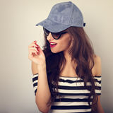 Happy enjoyment young woman in sunglasses and blue baseball cap Royalty Free Stock Images